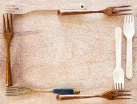 Wooden kitchenware frame on wooden background