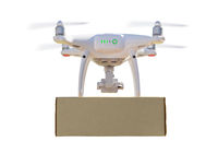 Back View of Unmanned Aircraft System (UAS) Quadcopter Drone Carrying Blank Package On White