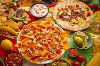 Various freshly made Mexican foods assortment. Placed on colorful table