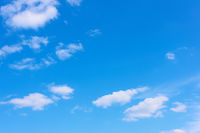 Blue sky with light white clouds -  background