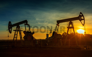 Two working oil pumps silhouette