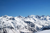 Snow covered mountains with mount Elbrus at background