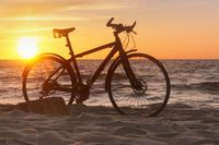 Bicycle at sunset, the silhouette of a Bicycle on the beach
