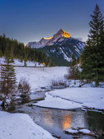 Sunset on the mountains along the highway in Kananaskis in the Canadian Rocky Mountains in winter