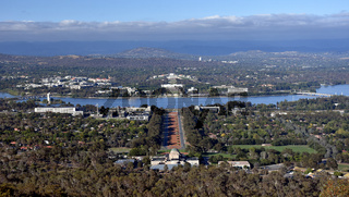 Panoramic view of Canberra, Australia in daytime from Mount Ainslie featuring the Australian War Memorial, Lake Burley Griffin, Molonglo River, Old Parliament House and New Parliament House.
