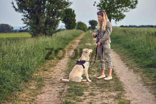 Attractive young woman teaching her dog