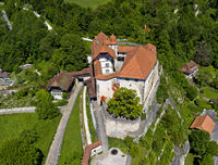 Laupen Castle rising on a sandstone spur, Laupen, canton Bern, Switzerland