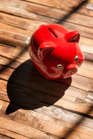 Red piggy bank with shadow