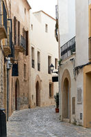 Charming empty cobblestone street of old town of Ibiza (Eivissa), Balearic Islands. Spain