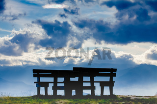 benches and table in the clouds