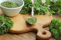 Chopped dry kale leaves on rustic background