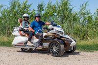 Motor bikers at tricycle Honda Goldwing making drive through Hungary