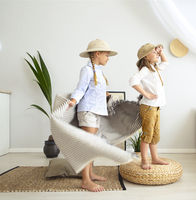 Two little girls are playing at home to travelers wearing vintage style clothes
