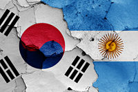 flags of South Korea and Argentina painted on cracked wall