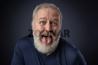 Portrait of an old man with the tongue out