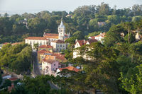 View of Sintra town with fairy building of City Hall among the thick green shade of trees. Portugal