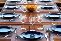 Table setting with a wine glasses, cutlery and plates