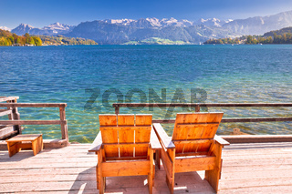 Relax deck chair by lake Luzern in Alps