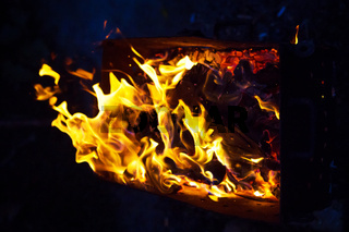 burning firewood in the grill, preparation for the frying of meat, close-up