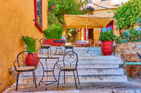 Street cafe on the stairs in Plaka in Athens,