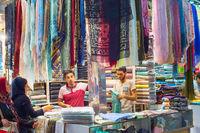 Woman buying shawls, Grand Bazaar