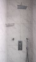 Modern shower with rain head and hand spray