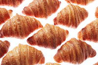 Close up homemade french croissants pattern on a white background.