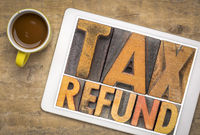 tax refund word abstract in wood type