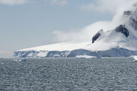 Calving Glacier And Clouds Covering The Coastline Of Paradise Bay, Antarctic Peninsula