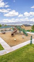 Panorama frame Playground and picnic area with beautiful homes and lake in the background
