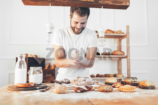 Baker with a variety of healthy and delicious freshly baked bread and pastry