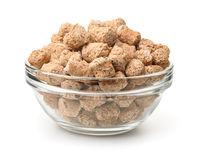Glass bowl of oats bran pellets