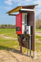 Dutch solar panel inverter outside in landscape