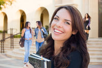 Smiling Mixed Race Young Girl with Books Walking On Campus