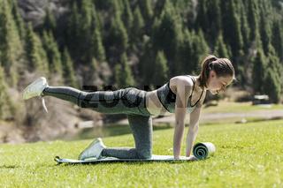 Yoga on a green lawn