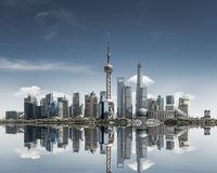 shanghai skyline against a sunny sky and reflection