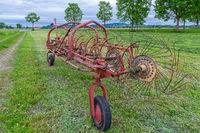 Old hay tedder on a meadow in Bavaria