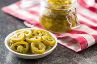 Slices of preserved Jalapeno pepper.