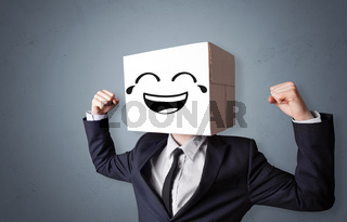 Funny man smiling with cardboard box head