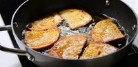 Frying bread in hot oil
