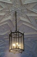 Stucco ceiling with hanging lamp