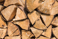 Logs stacked as firewood stock for winter - close-up