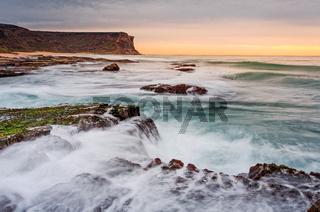 Waves and waterfalls coastal seascape