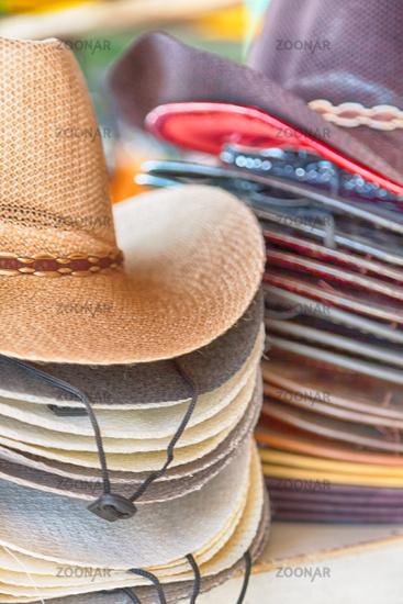 lots of fashion trandy hats in a market
