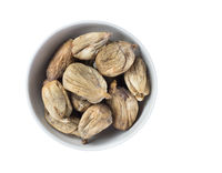 Full bowl of dried figs isolated on white background. Top view.