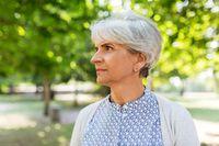 portrait of senior woman at summer park
