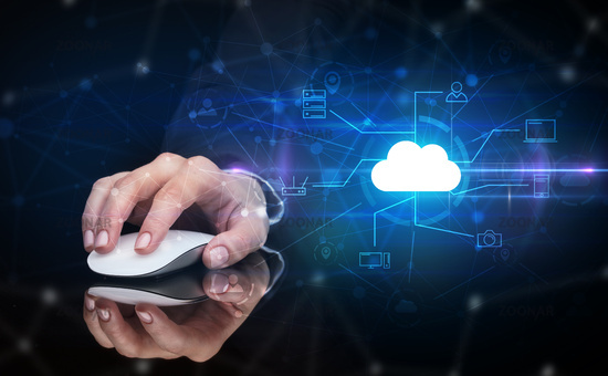 Hand using mouse with cloud technology and online storage concept