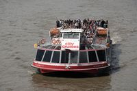 Crowded City Cruises boat on Thames