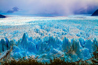 The cloudy sky and glacier Perito Moreno