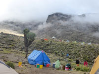 Mount Kilimanjaro / Tanzania: 4 January 2016: high camp on Mount Kilimanjaro with many people preparing and setting up camp
